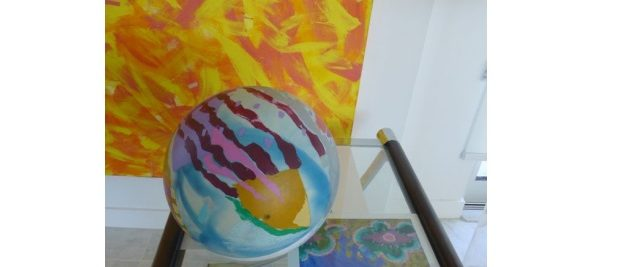 ball yellow painting glass table